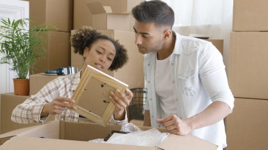 Thumbnail for Attractive Couple Unpacking Their Things in New Home