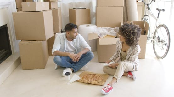 Cover Image for Young Couple Taking a Break From Moving House