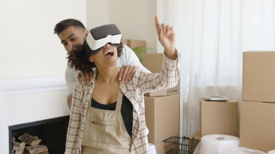 Thumbnail for Happy Young Couple Doing Virtual Tour in New Apartment