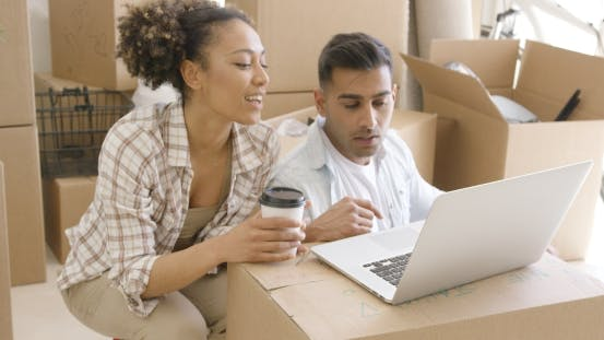 Thumbnail for Young Mixed Race Couple Using Laptop