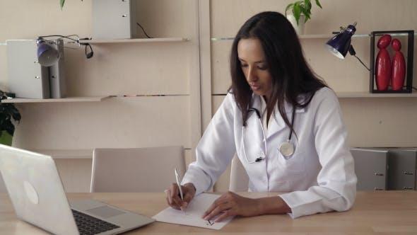Thumbnail for Woman Md Fill a Prescription
