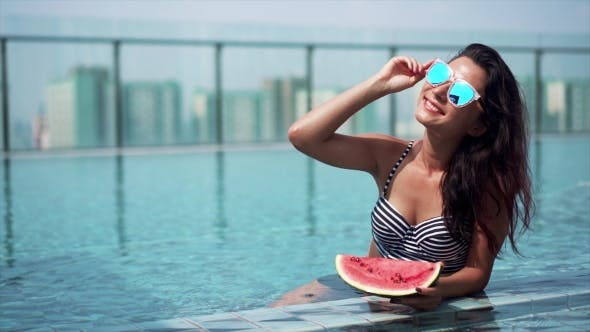 Thumbnail for Young Sexy Girl with Watermelon Slice in Pool