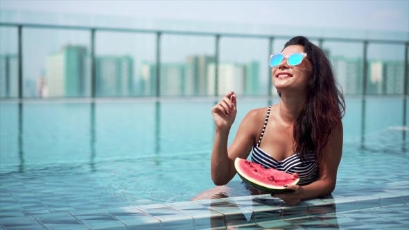 Thumbnail for Sexy Girl Eating Watermelon in the Pool