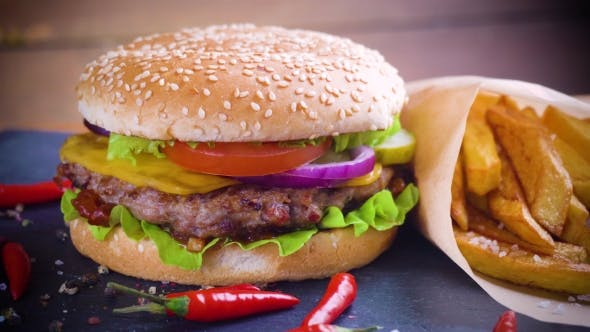 Thumbnail for Tasty Homemade Hamburger with Potatos Served on Stone Plate