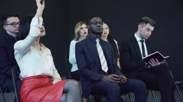 Thumbnail for Business Woman Raises Her Hand on Conference