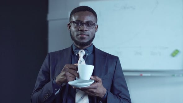 Thumbnail for Cheerful African American Businessman Having a Hot Drink