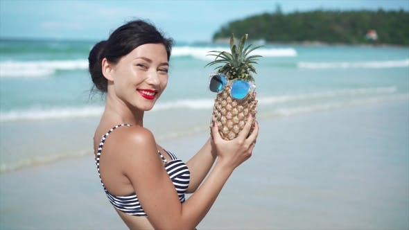 Thumbnail for Woman Having Fun with a Pineapple in Sunglasses