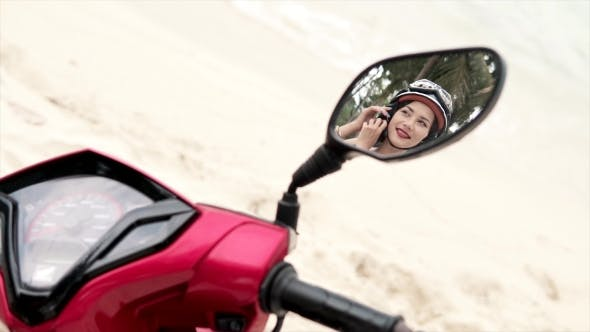 Thumbnail for Woman Putting Off Helmet - Reflection in a Mirror