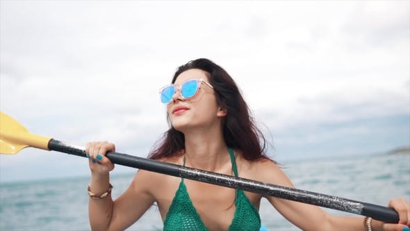 Thumbnail for Pretty Girl in Sunglasses Rowing in a Kayak