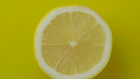 Thumbnail for The Cut Lemon on a Yellow Background.