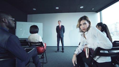 Bored Woman at the Meeting