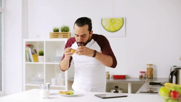 Thumbnail for Man with Tablet Pc Eating Breakfast at Home 25