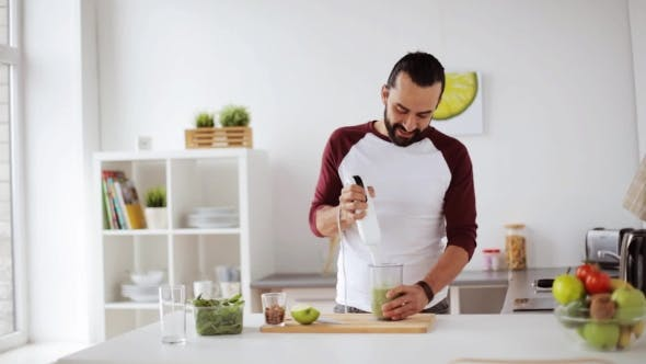 Thumbnail for Man with Blender Cooking Smoothie at Home Kitchen 11