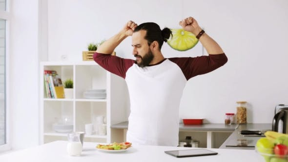Thumbnail for Man Eating Breakfast and Dancing at Home 33