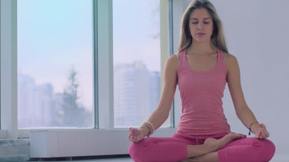 Thumbnail for Beautiful Young Woman Practicing Seated Pose While Meditating