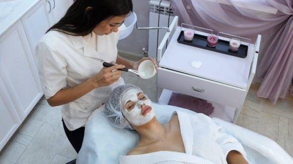 Thumbnail for Beautiful Woman Getting Facial Mask at Beauty Salon