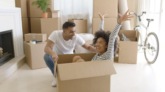 Thumbnail for Happy Mixed Race Couple Having Fun Break with Unpacking