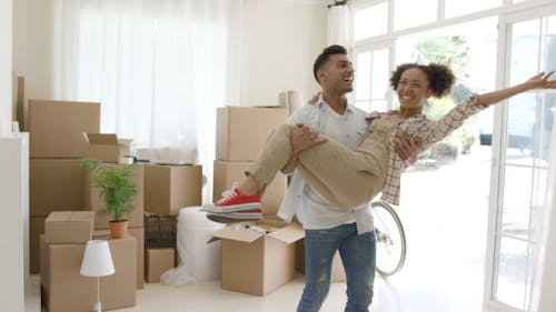 Ecstatic Young Couple Celebrating Their New Home