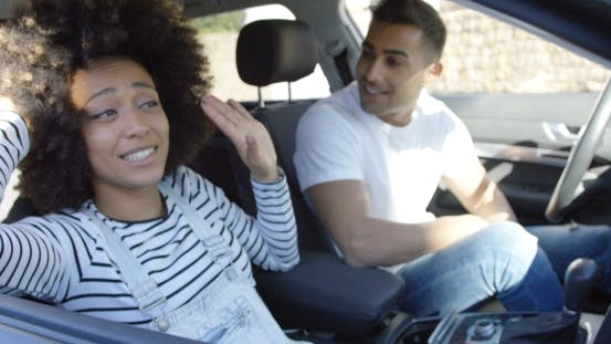 Thumbnail for Playful Young Woman Goofing Around in a Car