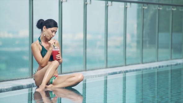 Thumbnail for Young Pretty Sexy Woman Drinking Cocktail in Pool