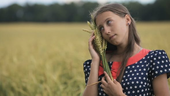 Thumbnail for Beautiful Young Teen Girl with Ears of Wheat in a Wheat Field