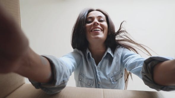 Thumbnail for Smiling Woman Taking Something From the Box