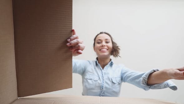 Thumbnail for Beautiful Woman Opens the Box. POV