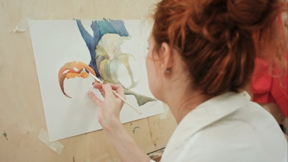 Thumbnail for Woman Artist Painting a Picture in Studio While Talking on the Phone