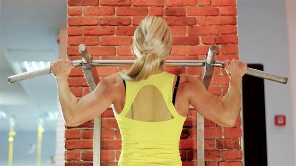 Thumbnail for Female Bodybuilder Champion Athlete Gym, Girl Performs a Pulling Up Exercise, Healthy Strong Body