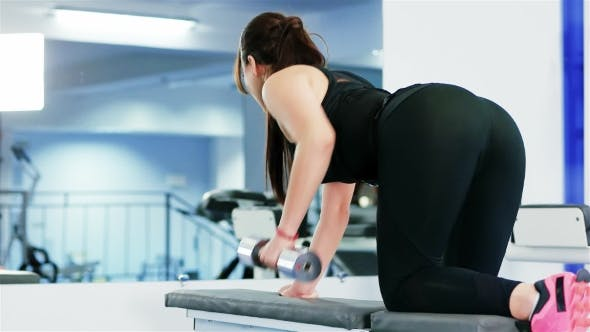 Thumbnail for Athlete Girl Performs Exercises with Dumbbell at Hard Training in the Gym, Athletic Woman Pumping Up