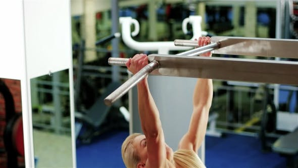 Thumbnail for Fitness Workout, Female Bodybuilder Champion Athlete Gym, Girl Performs a Pulling Up Exercise
