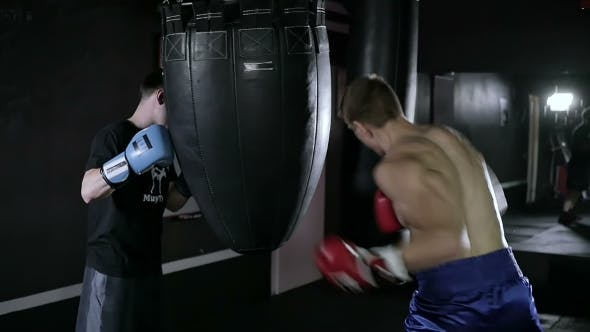Cover Image for Coach Holds the Punching Bag for His Sportsman.