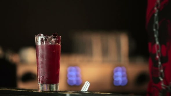 Thumbnail for Barman Adds Berries and Sparkling Water.