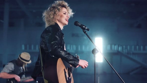 Woman in Leather Jacket Singing
