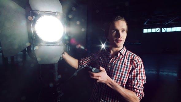 Thumbnail for Man Turning on Studio Light