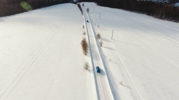 Cover Image for Car on Winter Road. Winter Landscape.