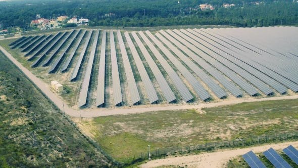 Thumbnail for Aerial View Over Solar Panel Farm