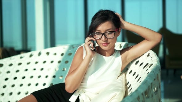 Thumbnail for Girl Student Using Phone in High Business Interior
