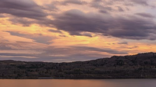 Pastel Colored Sunset Clouds Over Lake