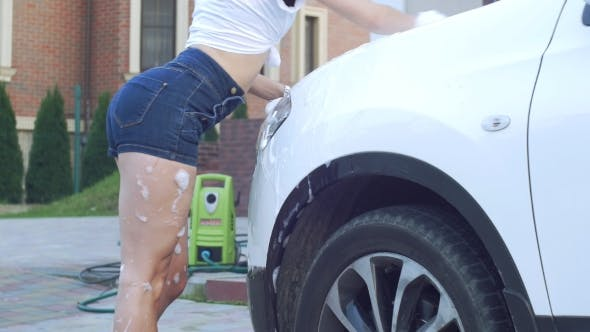 Thumbnail for Girl in Shorts To Wash Car
