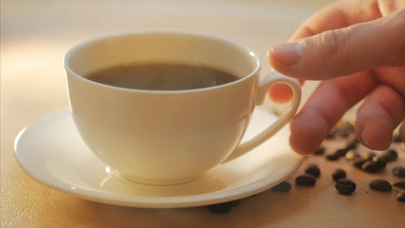 Thumbnail for A Man Takes a Cup of Hot Steaming Coffee