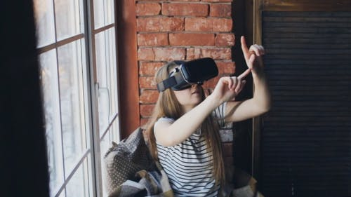 Woman Using Augmented Reality Headset at Home