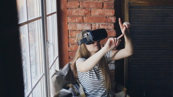 Thumbnail for Woman Using Augmented Reality Headset at Home