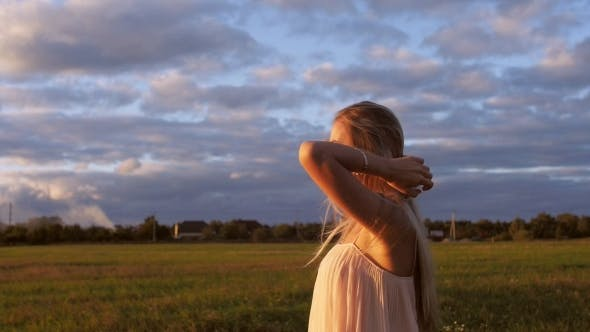 Thumbnail for Beautiful Girl Walking in the Field at Sunset