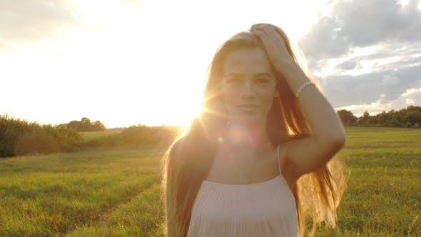 Thumbnail for She Goes Through Hair on a Background of the Sun