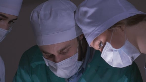 Thumbnail for Doctors Surgeons Operate Patient in Operating Theater