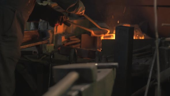 Thumbnail for Blacksmith Works in His Workshop