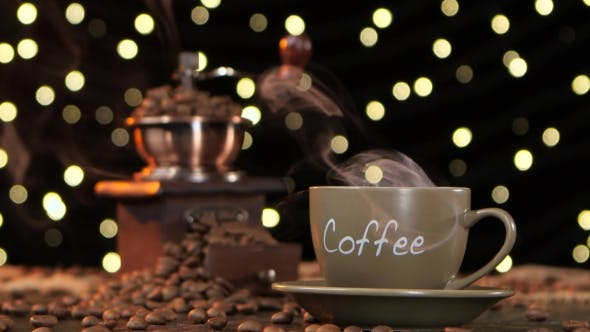 Thumbnail for Hot Coffee with a Smoke in Cup and Coffee Grinder