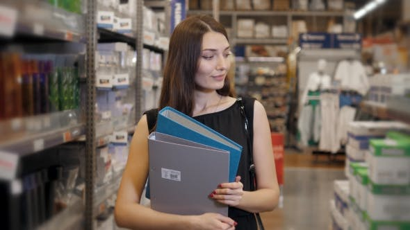 Thumbnail for Young Brunette Woman Choosing the Right File