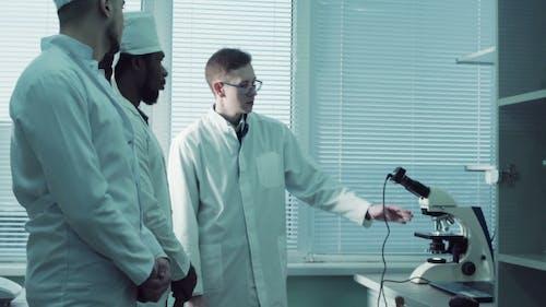 Tutor Showing Electron Microscope